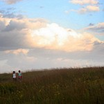 Hikers on Audubon Spring Creek Prairie - Photo by Paul A. Johnsgard
